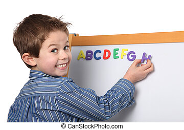 young boy learning the ABC