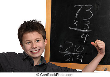 doing the math - young boy cheering over his math success