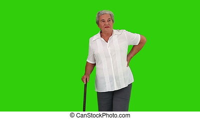 Retired woman walking with a stick - Chromakey footage of a...