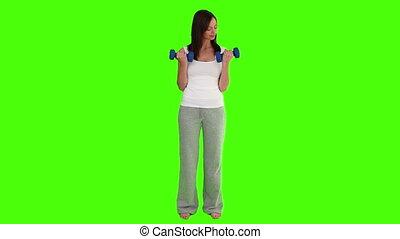 Brunette female doing exercise with dumbbells