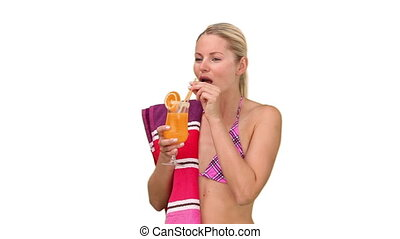 Attractive woman in swimsuit drinking cocktail