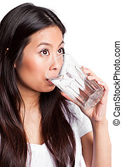 Asian woman drinking water - An isolated shot of a beautiful...