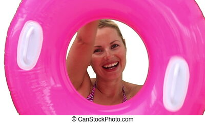 Pretty woman in swimsuit playing with a rubber ring