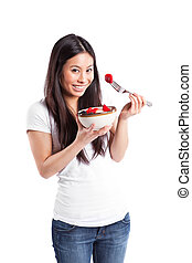 Asian woman eating fruit - An isolated shot of an asian...