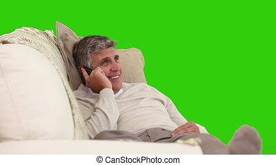 Middle age man laughing on the phone