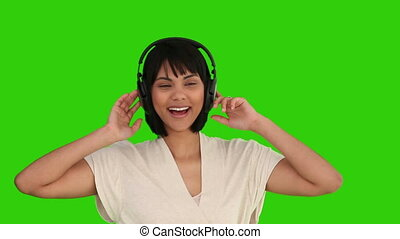 Asian woman dancing with headphones