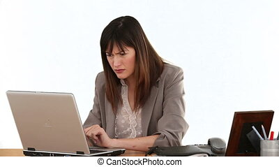 Brunette businesswoman becoming nervous in front of her laptop