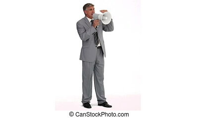 Man in suit talking through a megaphone
