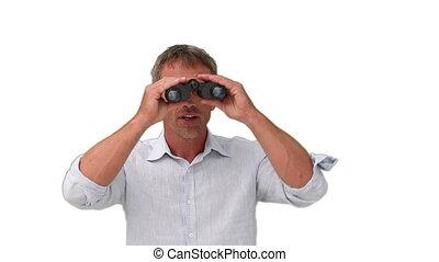 Elderly man using a pair of binoculars