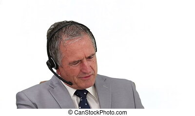 Man in a call center making a phone call