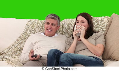 Pretty couple watching tv - Chroma-key footage of a pretty...