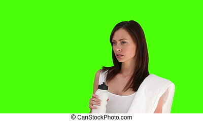 Pretty woman drinking water after sport - Chromakey footage...