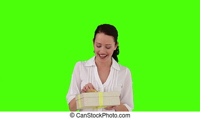 Cute brunette woman opening a gift - Chroma-key footage of a...