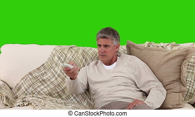 Retired man glqd to watch TV - Chromakey footage of a...