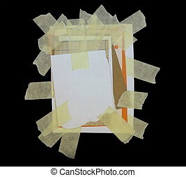 paper scraps and masking tape isolated on black background