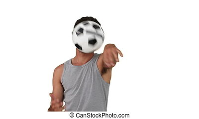 Dark-haired man playing with a soccer ball