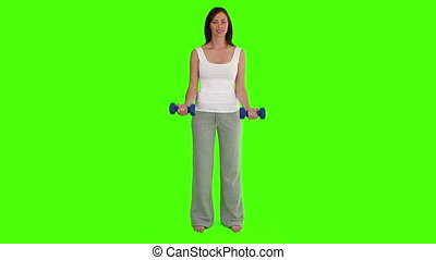 Dark-haired woman doing bodybuilding exercises