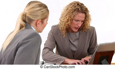 Businesswomen during a meeting having a problem at a desk
