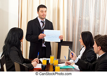 Business man showing graphic at meeting - Business man...