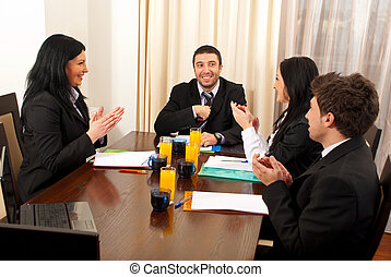 Business people clapping hands at meeting - Three business...