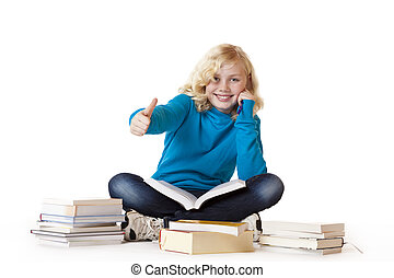 Schoolgirl sitting with books on floor and showing thumb up....