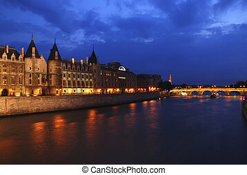 Palais de Justice standing on the banks of river Seine on...