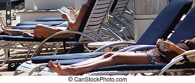Cruise Vacation. - Women relaxing on the deck of a cruise...