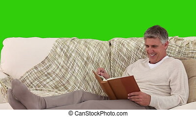 Casual senior man laughing in front of an album - Chromakey...