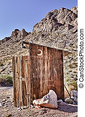 Outhouse on the desert - An old toilet or outhouse sitting...