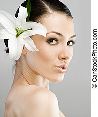 flower girl - a beauty girl on the grey background