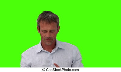 Casual man playing with cards - Chromakey footage of a...