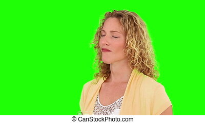Curly blond haired woman drinking glass