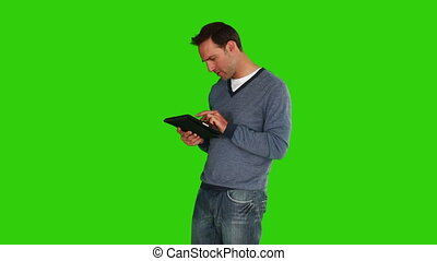 Casual man using a touch pad - Chroma-key footage of casual...