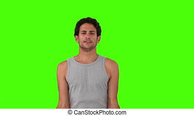 Dark-haired man doing exercise with dumbbells - Chroma-key...