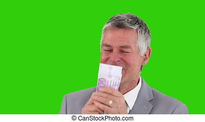 Businessman in grey suit counting his cash