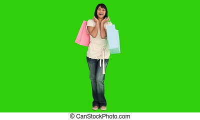 Pretty asian woman with shopping bags - Chromakey footage...