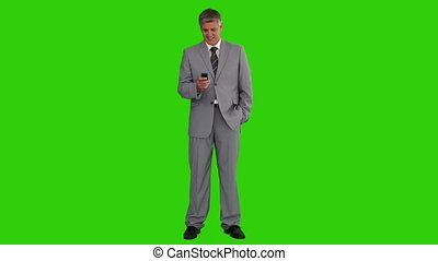 Businessman in grey suit with a remote control - Chroma-key...