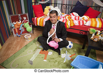 Mature man playing with toys - Mature man in full suit...