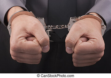 Arrest handcuffs - Arrest, close-up shot mans hands with...