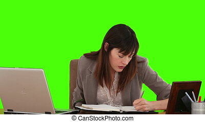 Businesswoman writing something on her diary - Chroma-key...