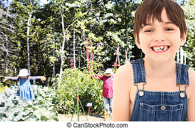 Farm Boy in Garden with Scarecrows - Adorable 7 year old...