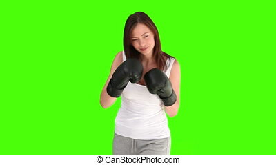 Brunette woman in sportswear with boxing gloves - Chromakey...