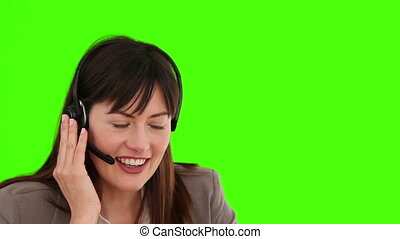 Businesswoman with an headset talking - Chroma-key footage...