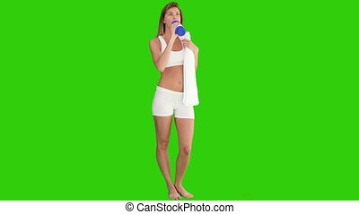 Pretty lady drinking water after sport - Chroma-key footage...