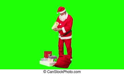 Santa Claus packing - Chroma-key footage of a Santa Claus...