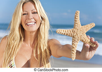 Beautiful Girl Smiling on Beach With Starfish