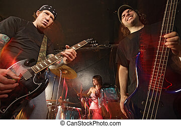 Rock band performing - Band playing on a stage. Guitarist,...