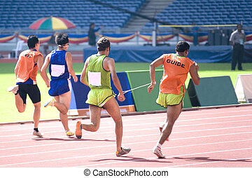 Mens 100 Meters for Blind Persons - Blind athletes competing...
