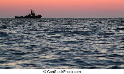Sea 08 - Sea sunset. Tugboat.