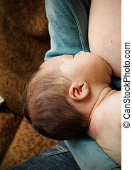 Breastfeeding Baby - A baby feeding at the breast.